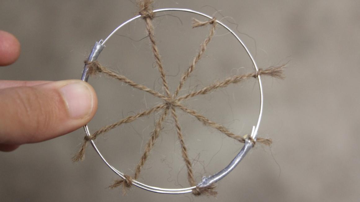 Hand spun spokes over a wire frame.